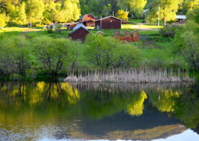 Pass Creek Ranch barns across lake