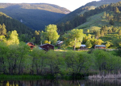 Pass Creek Ranch barns and mountains